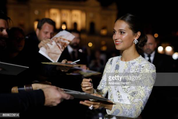 Alicia Vikander writes autographs as she attends the 'Euphoria' premiere during the 13th Zurich Film Festival on September 29 2017 in Zurich...