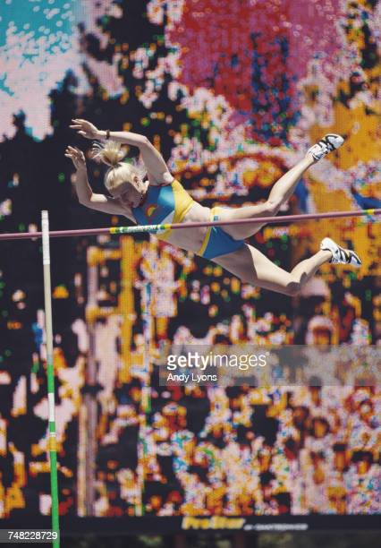 Alicia Warlick attempts to clears the bar during the Women's Pole Vault event at the United States Olympic Trials for track and field on 23 July 2000...