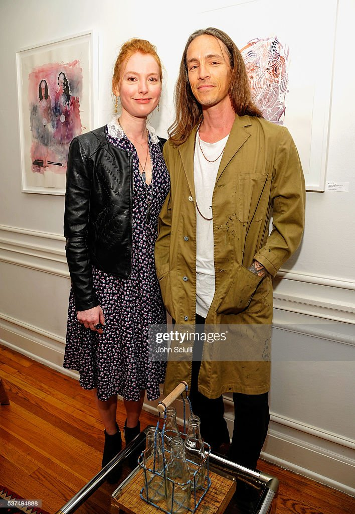 Alicia Witt, actress, singer/songwriter/pianist, Brandon Boyd, artist, singer/songwriter attend The Art of Elysium and The Macallan's Men In The Arts: The Work of Brandon Boyd on June 1, 2016 in Los Angeles, California.