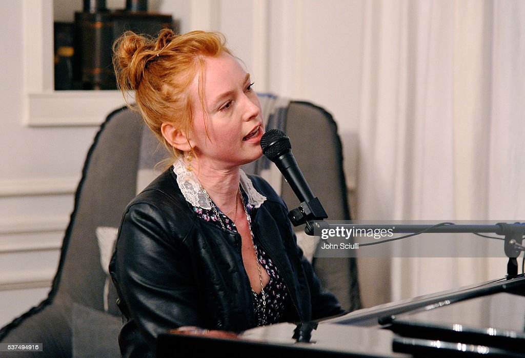 Alicia Witt, actress, singer/songwriter/pianist performs at The Art of Elysium and The Macallan's Men In The Arts: The Work of Brandon Boyd on June 1, 2016 in Los Angeles, California.