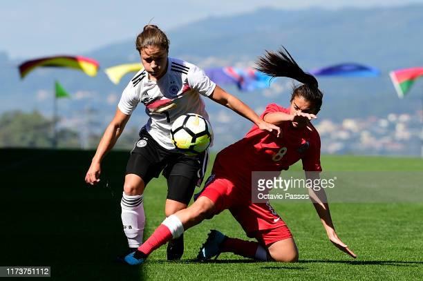AliciaSophie Gudorf of Germany competes for the ball with Aytaj Nematova of Azerbaijan during the UEFA Women's U19 European Championship Qualifier...