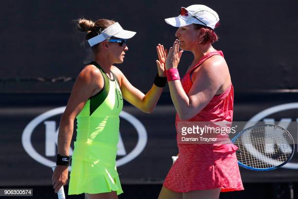Alicja Rosolska of Poland and Abigail Spears of the United States compete in their first round women's doubles match against Alize Cornet of France...