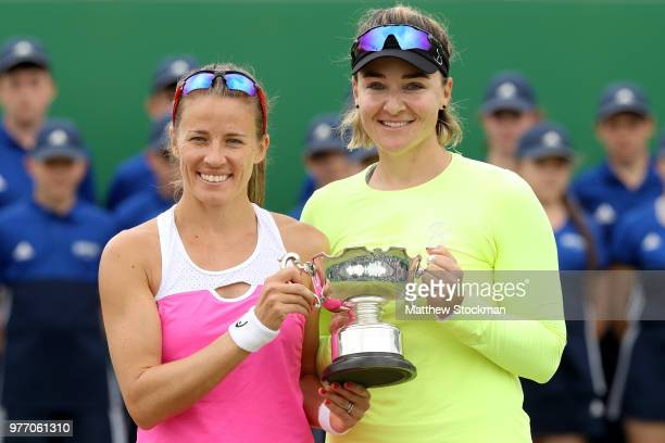 Alicja Rosolska of Poland and Abigail Spears of the United States pose with the winner's trophy during their women's doubles final match against...