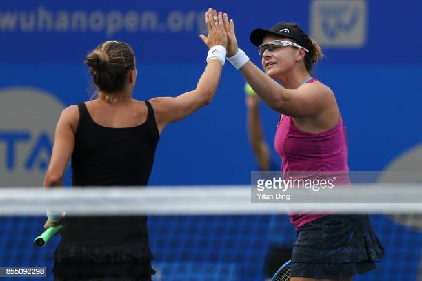 Alicja Rosolska of Poland and Abigail Spears of United States react during the ladies double quarterfinals between Peng Shuai of China and Sania...