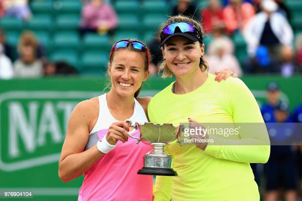Alicja Rosolska of Poland and Abigail Spears of USA celebrate victory in the Womens Doubles Final during Day Nine of the Nature Valley Open at...