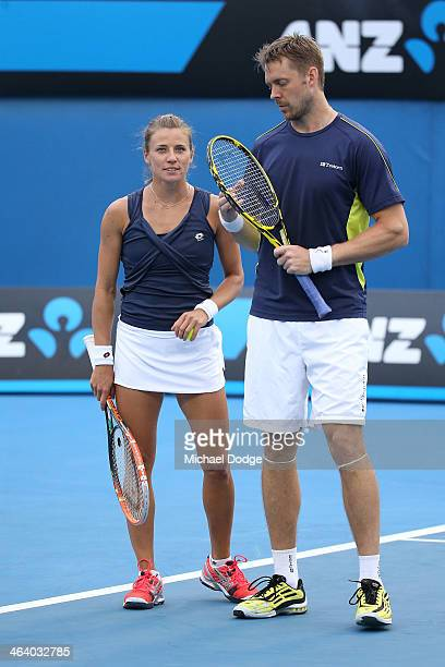 Alicja Rosolska of Poland and Johan Brunstrom of Sweden of the United States in action in their first round mixed doubles match against Jie Zheng of...