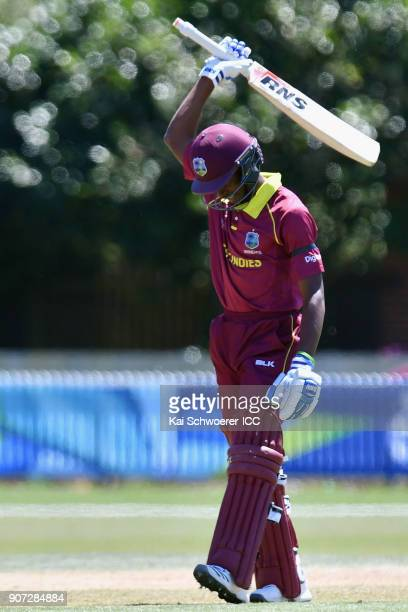 Alick Athanaze of the West Indies celebrates his century during the ICC U19 Cricket World Cup match between the West Indies and Kenya at Lincoln Oval...