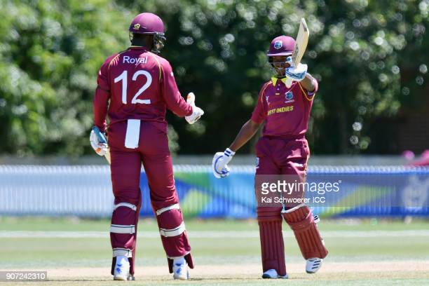 Alick Athanaze of the West Indies celebrates his half century during the ICC U19 Cricket World Cup match between the West Indies and Kenya at Lincoln...