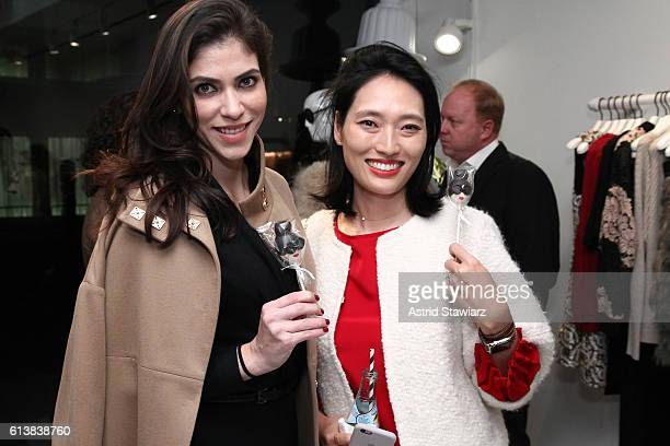 """Alida Boer and Amanda Chu pose for a photo together as Sara Blakely and Alice + Olivia celebrate the launch of """"The Belly Art Project"""" on October 10,..."""