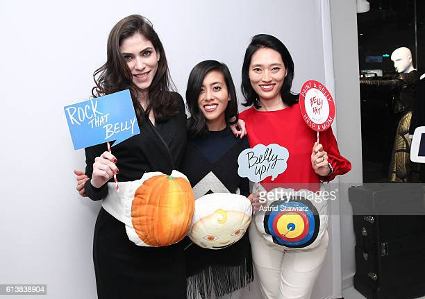 """Alida Boer, Ann Wang and Amanda Chu pose for a photo together as Sara Blakely and Alice + Olivia celebrate the launch of """"The Belly Art Project"""" on..."""