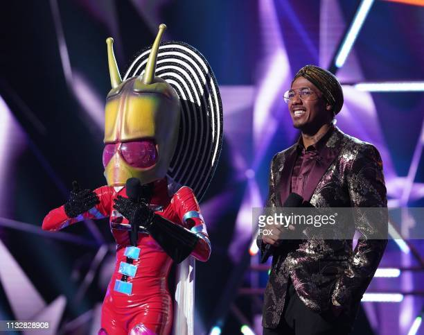 Alien and host Nick Cannon in the All Together Now episode of THE MASKED SINGER airing Wednesday Feb 13 on FOX