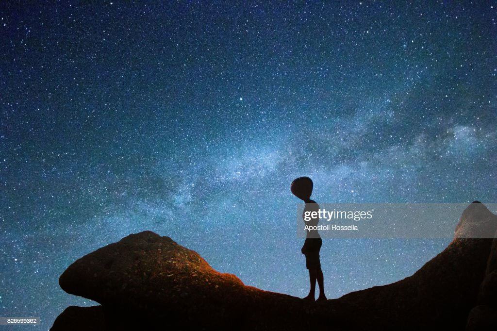 Alien and milky way : Stock Photo