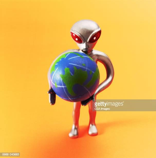 Alien Doll Holding Globe