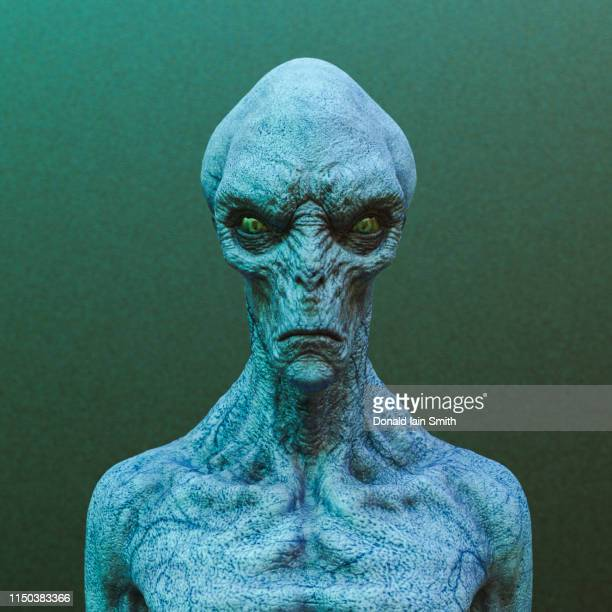 alien head and shoulders portrait - alien stock-fotos und bilder