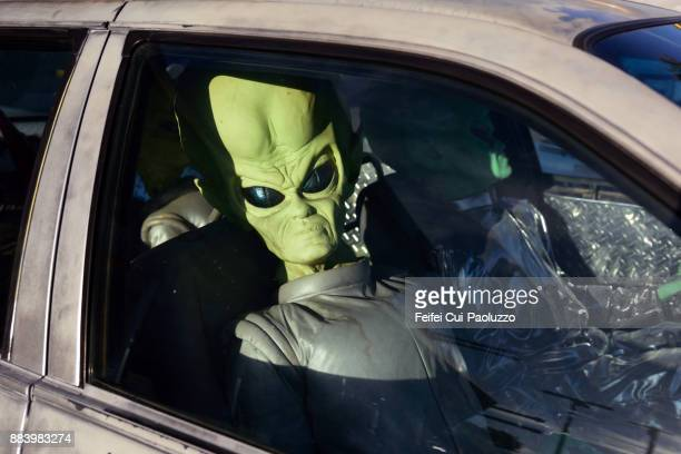 Alien in a car at Baker of California state in USA