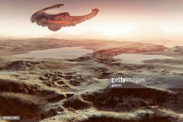 Alien spaceship flying over Martian landscape with water