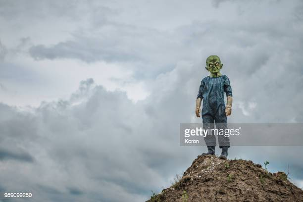 Alien standing on the mountain
