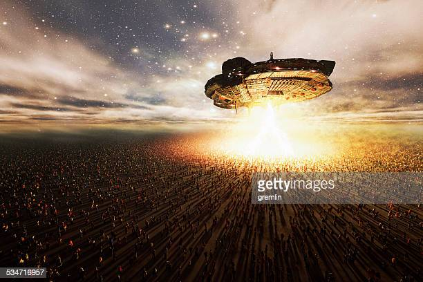alien ufo hovering over great masses of people, abduction, invasion - spaceship stock photos and pictures