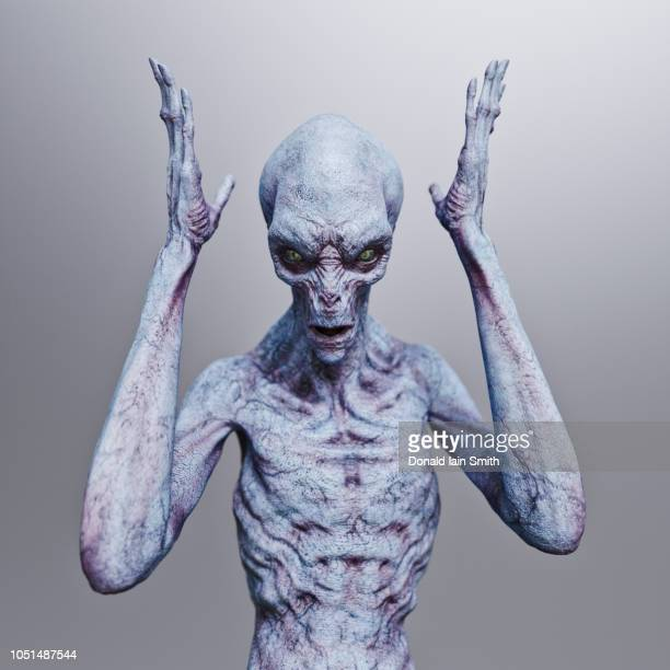alien with hands in air and expression of anger or frustration - alien stock-fotos und bilder