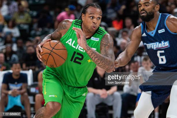 Aliens player Shannon Brown drives by Triplets player Alan Anderson during the Big3 basketball game between the Triplets and Aliens on June 23, 2019...