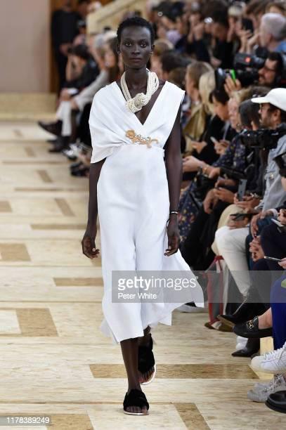 Aliet Sarah walks the runway during the Miu Miu Womenswear Spring/Summer 2020 show as part of Paris Fashion Week on October 01, 2019 in Paris, France.