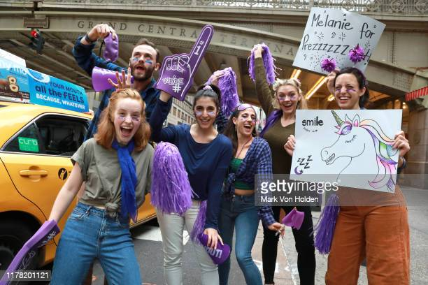 Aligner groupies are seen cheering during the SmileDirectClub Nighttime Clear Aligners Activation with Jordan Fisher at Grand Central Station on...