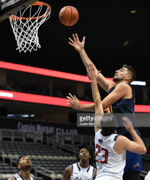 Alihan Demir of the Drexel Dragons goes to the basket against Matty McConnell of the Robert Morris Colonials in the first half during the game at PPG...