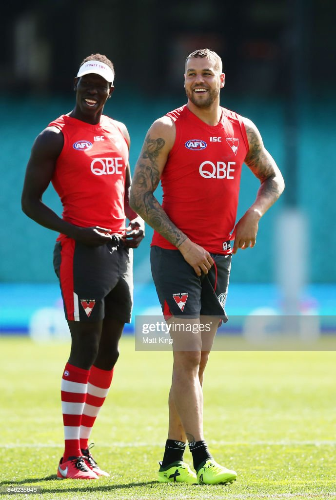 Aliir Aliir (L) and Lance Franklin (R) of the Swans look on during a Sydney Swans AFL training session at Sydney Cricket Ground on September 13, 2017 in Sydney, Australia.