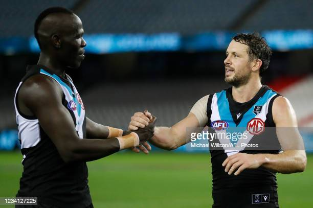 Aliir Aliir and Travis Boak of the Power celebrate during the 2021 AFL Round 19 match between the Port Adelaide Power and the Collingwood Magpies at...