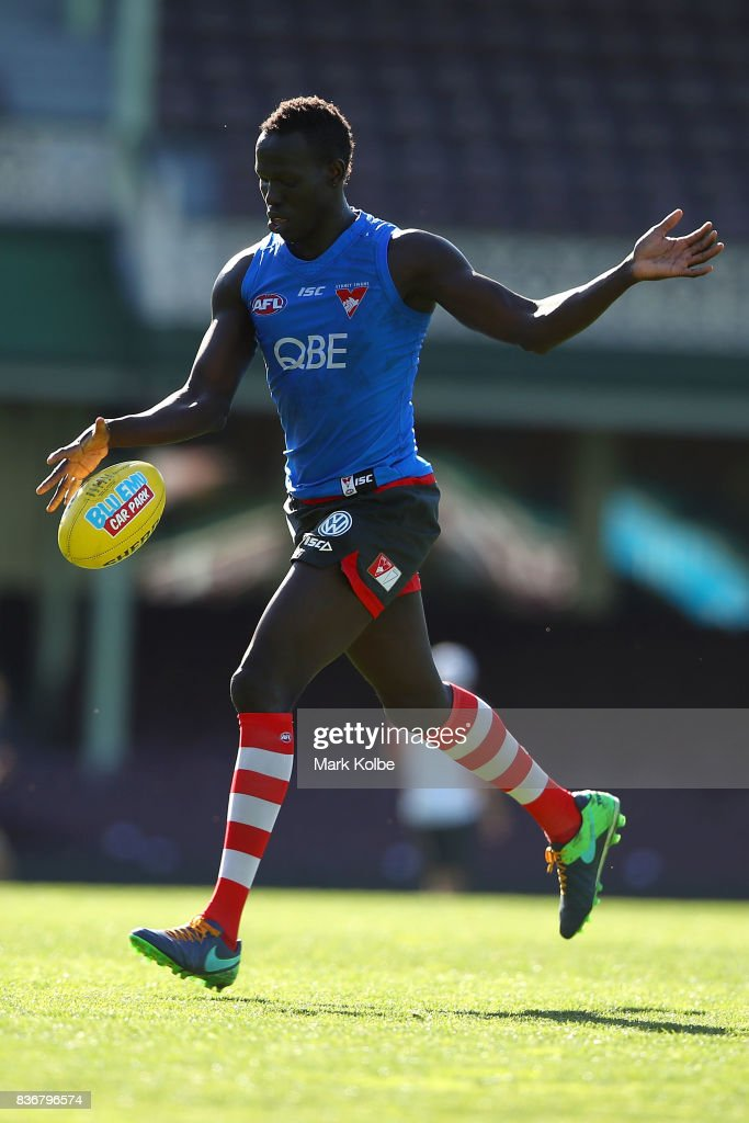Aliir Aliir kicks during a Sydney Swans AFL training session at Sydney Cricket Ground on August 22, 2017 in Sydney, Australia.