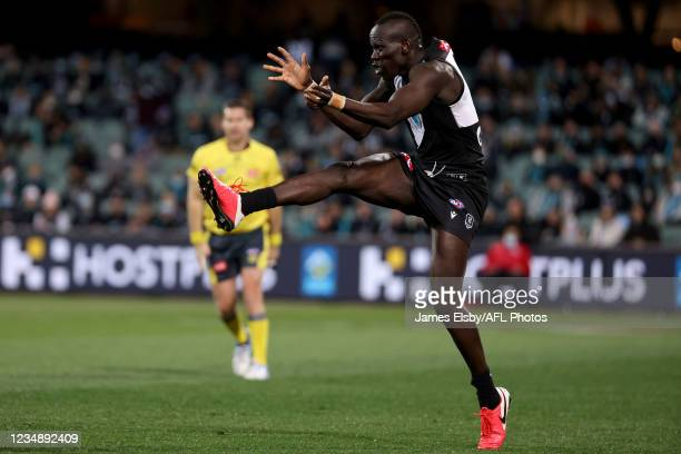 Aliir Aliir of the Power kicks the ball during the 2021 AFL Round 23 match between the Adelaide Crows and the North Melbourne Kangaroos at Adelaide...