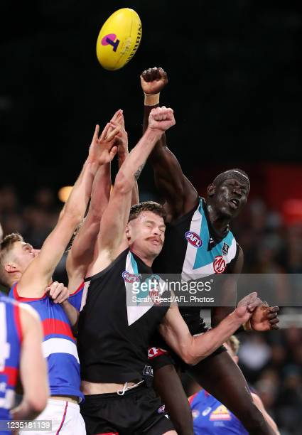 Aliir Aliir of the Power Punches the ball away during the 2021 AFL Second Preliminary Final match between the Port Adelaide Power and the Western...