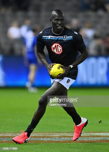 Aliir Aliir of the Power warms up during the round one AFL match between the North Melbourne Kangaroos and the Port Adelaide Power at Marvel Stadium...