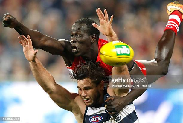 Aliir Aliir of the Swans and Tom Hawkins of the Cats compete for the ball during the 2016 AFL Round 16 match between the Geelong Cats and the Sydney...