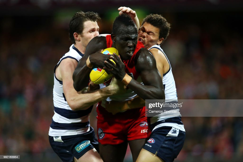 Aliir Aliir of the Swans is tackled during the round 16 AFL match between the Sydney Swans and the Geelong Cats at Sydney Cricket Ground on July 5, 2018 in Sydney, Australia.