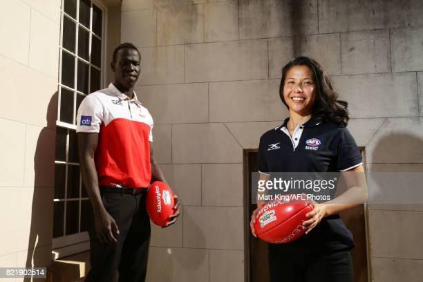 Aliir Aliir of the Sydney Swans and Mai Nguyen of the GWS Giants pose during the AFL Multicultural Round Media Launch at Lachlan's Old Government...