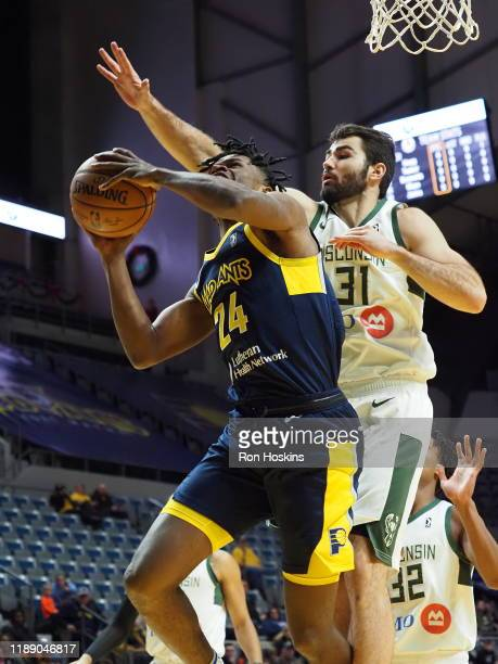 Aliize Johnson of the Fort Wayne Mad Ants battles Luke May of the Wisconsin Herd on December 16 2019 at Memorial Coliseum in Fort Wayne Indiana NOTE...