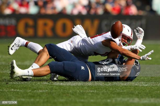 Alijah Holder of Stanford contests the ball with Robby Wells III of Rice during the College Football Sydney Cup match between Stanford University and...
