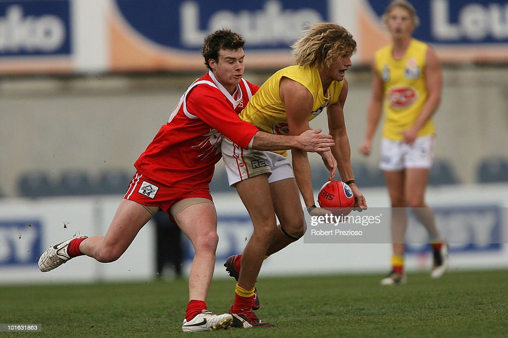 Alik Magin of the Gold Coast handballs under pressure during the round eight VFL match between the Bullants and the Gold Coast on June 5, 2010 in Melbourne, Australia.