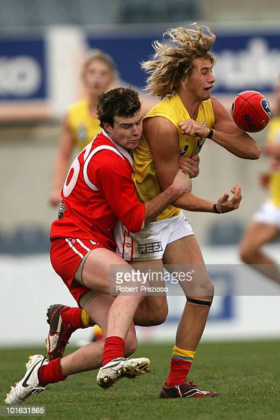 Alik Magin of the Gold Coast handballs under pressure during the round eight VFL match between the Bullants and the Gold Coast on June 5, 2010 in...