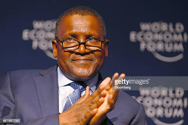 Aliko Dangote billionaire and chief executive officer of Dangote Group gestures during a session on day two of the World Economic Forum in Davos...