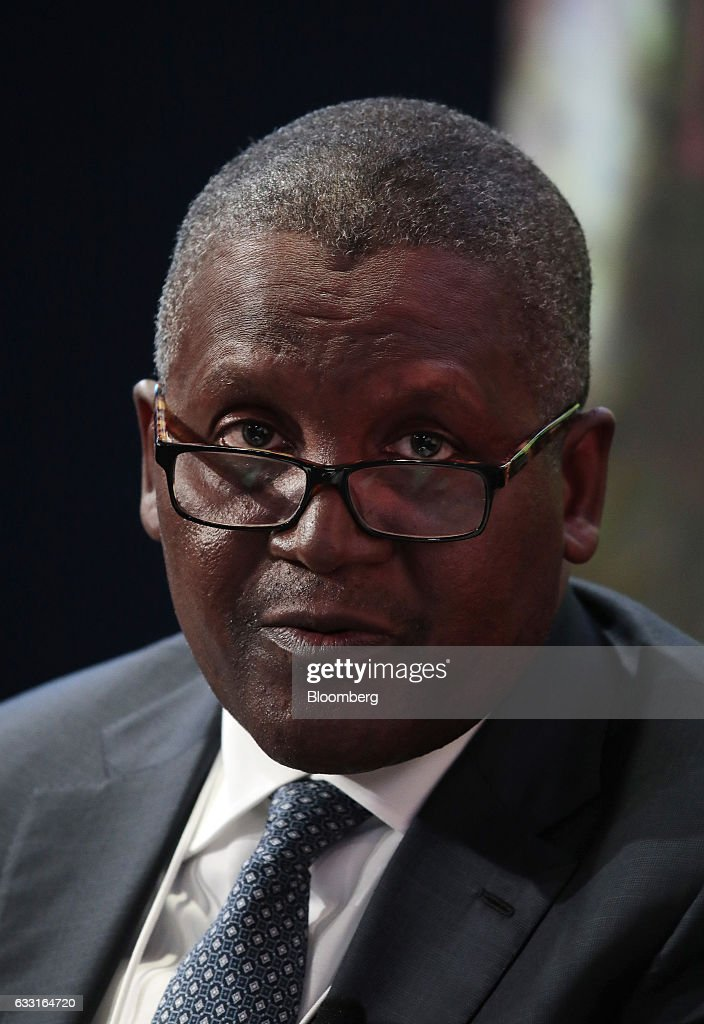 Aliko Dangote, billionaire and chief executive officer of Dangote Group, speaks during a panel session at the World Economic Forum (WEF) in Davos, Switzerland, on Tuesday, Jan. 17, 2017. World leaders, influential executives, bankers and policy makers attend the 47th annual meeting of the World Economic Forum in Davos from Jan. 17 - 20. Photographer: Jason Alden/Bloomberg via Getty Images