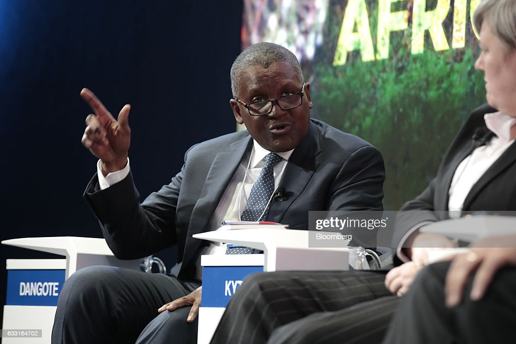 Aliko Dangote, billionaire and chief executive officer of Dangote Group, gestures as he speaks during a panel session at the World Economic Forum (WEF) in Davos, Switzerland, on Tuesday, Jan. 17, 2017. World leaders, influential executives, bankers and policy makers attend the 47th annual meeting of the World Economic Forum in Davos from Jan. 17 - 20. Photographer: Jason Alden/Bloomberg via Getty Images