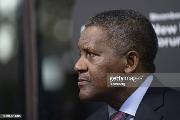 Aliko Dangote president and chief executive officer of Dangote Group listens during a Bloomberg Television interview on the sidelines of the...