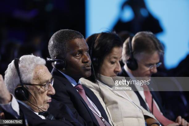 Aliko Dangote president and chief executive officer of Dangote Group second left attends the Bloomberg New Economy Forum in Singapore on Tuesday Nov...