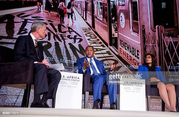 Aliko Dangote president and chief executive officer of Dangote Sugar Refinery Plc center speaks as Jasandra Nyker chief executive officer of BioTherm...