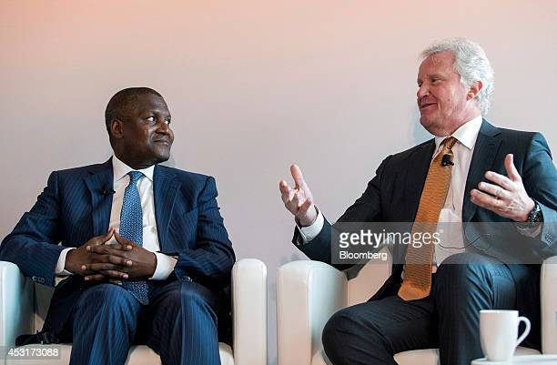 Aliko Dangote president of Dangote Group right listens to Jeffrey Immelt chairman and chief executive officer of General Electric Co during a forum...