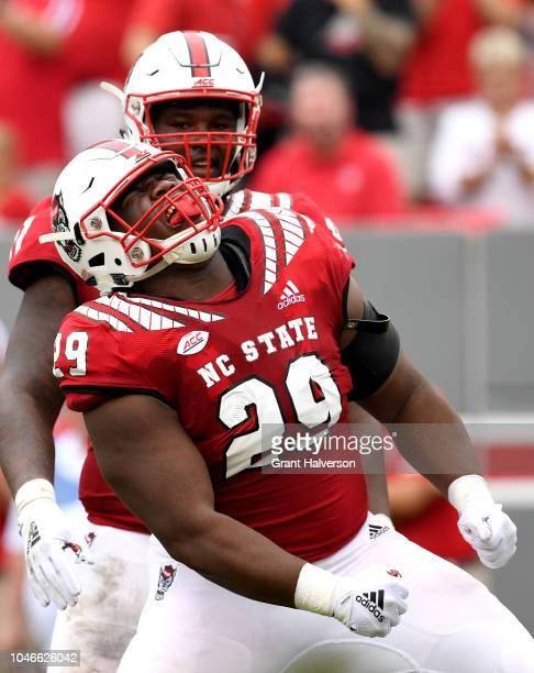 Alim McNeill of the North Carolina State Wolfpack reacts after making as tackle for a loss against the Boston College Eagles during their game at...