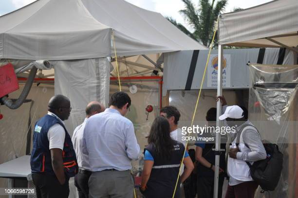 ALIMAs coordinator seen showing the interior of an isolation CUBE to the team of international response to the 10th epidemic of Ebola virus in DRC....