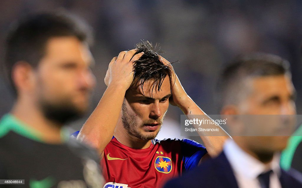 BELGRADE, SERBIA - AUGUST 05. Alin Tosca (C) of FC Steaua Bucharest look dejected after the UEFA Champions League Third Qualifying Round Second Leg match between FC Partizan Belgrade and FC Steaua Bucharest at FC Partizan stadium in Belgrade, Serbia on Wednesday, August 05, 2015.